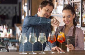 manager teaches new bar tender