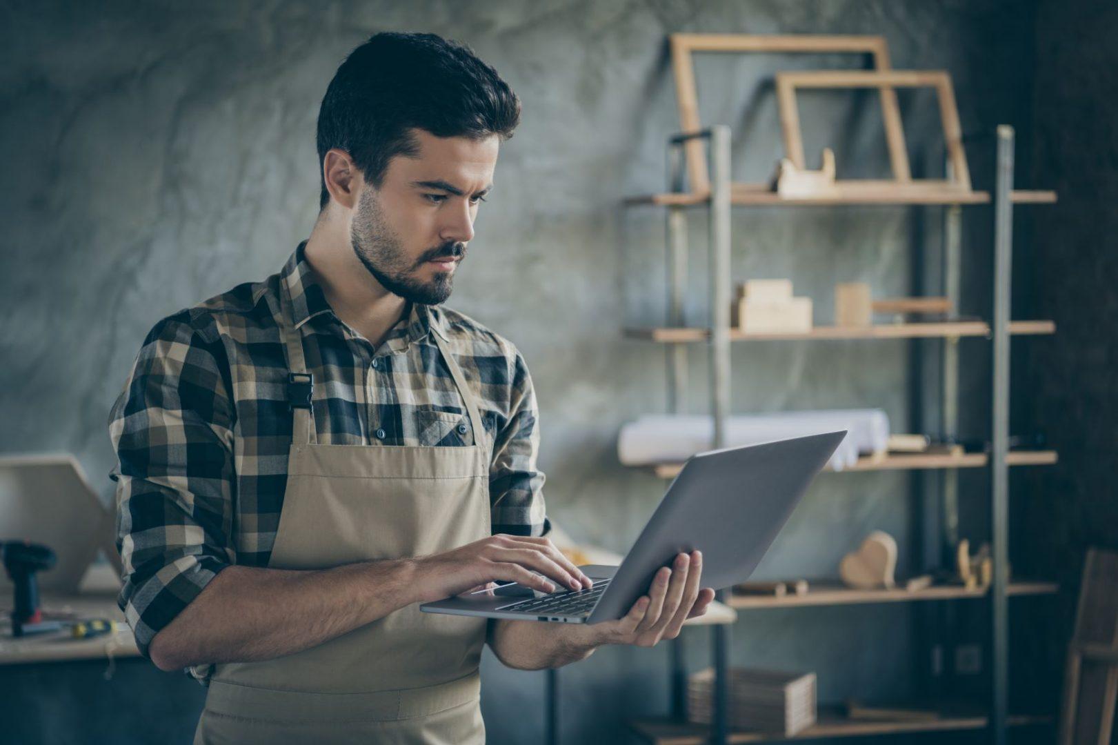 retail employee on training using laptop